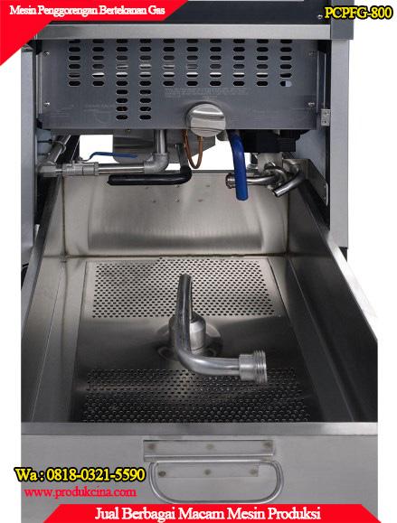 Tampilan bagian dalam mesin penggorengan terbuka